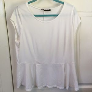 The limited white tee with peplum bottom Sz XL